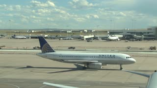 United Plane Taxiing to Runway Takeoff
