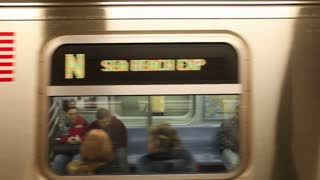 United States of America, New York, New York City, Manhattan, Subway Station and train in motion