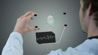 Unrecognizable scientist, doctor hands using futuristic touchscreen technology, showing x-ray. Motion graphic