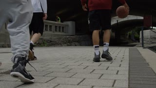 Urban Basketball - Sports Athletes - Young men dribbling and shooting hoops