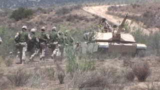 U.S. Marines and Royal Canadian Infantry Regiment conduct a mechanized assault