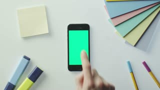 Using Mobile Phone with Green Screen on Designer's Table. Great For Mock-up Usage.