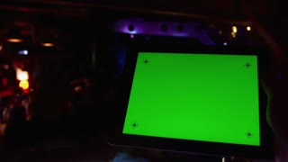 Using the tablet PC with a green screen at a concert in a nightclub.