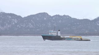Utility Boat Passing Mountains And Other Ships