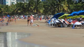 Vacationers On Puerto Rico Beach