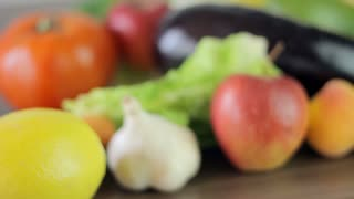 Vegetables and fruits on the table, food cooking, healthy food, close-up, camera movement