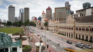 Vehicle traffic in Merdaka Square including the Sultan Abdul Samad Building, Kuala Lumpur, Malaysia, Asia, Time lapse