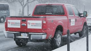 Video Blocks Truck Parked on Street in Snow
