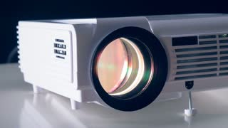 Video, film, TV projector working in a dark room. Close up view