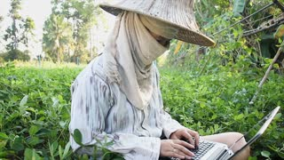 4 K Farmer Using Laptop Computer In The Farm