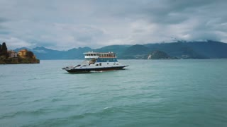 4K Aerial Flying Around Ferry Boat Coming into Lake Como Shore