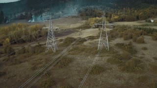 4K Aerial Flying Over Power Line Towers in the Country