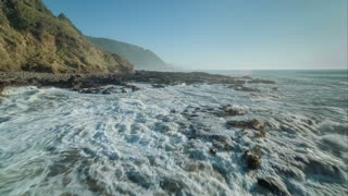 4K Aerial Flying Over Rocky Ocean Shoreline