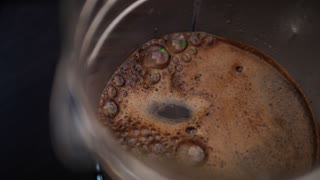 4K Slow Mo Shot Pouring Water into Coffee