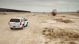 4K UHD Aerial Following Border Patrol Along Mexican Border Wall