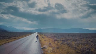4K UHD Aerial Shot Hitchhiker On Lonely Country Road