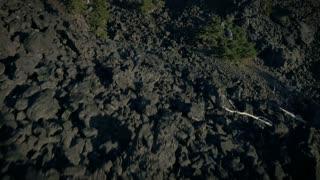 4K UHD Aerial Tilt Up Over Lava Rock Field