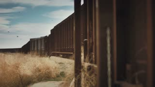 4K/UHD Cinematic Dolly of Mexico Border Wall