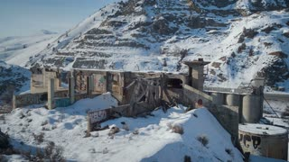 4K/UHD Drone of Post Apocalyptic Buildings in Snow