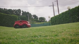 4K UHD Ground Level Shot of Robot Lawn Mower