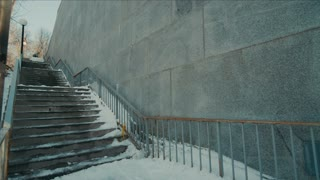 4K UHD Shot of Man Snowboarding Down Railing