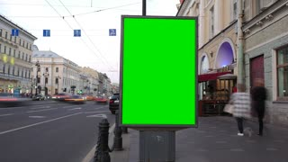 a Billboard With a Green Screen on a Busy Street. Time Lapse.