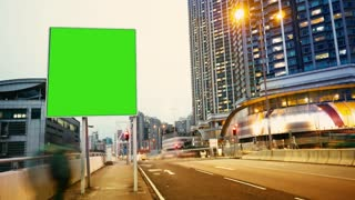 a Billboard With a Green Screen on a Evening Streets of Hong Kong .time Lapse