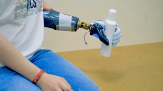 A disabled woman using robot-assisted bionic arm.