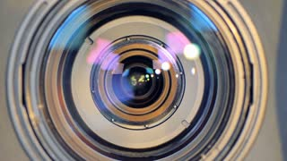 A macro view on a camera lens changing focus.