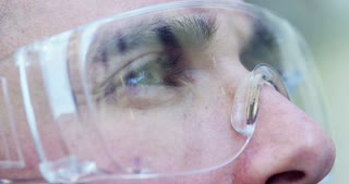 A man watches with futuristic glasses augmented reality in holography.