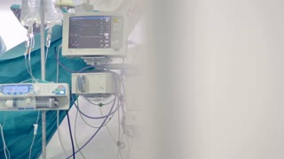 A set of medical equipment showing patients vitals and an IV bag. 4K.