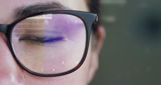 A woman watches with a futuristic look with glasses. augmented reality in holography.