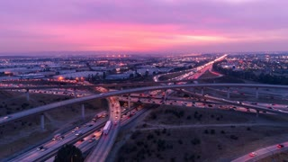 Aerial hyper lapse of cars on freeway and highway with lights in heavy traffic during rush hour.