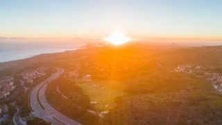 Aerial hyperlapse timelapse of stunning sunset over Pelican Hill golf course and Newport Beach harbor in Orange County in California 4K UHD.