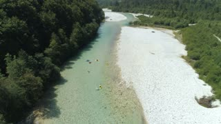 AERIAL Kayakers enjoy beautiful outdoors while gliding down clear river stream
