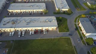 Aerial of active industrial buildings small warehouse spaces