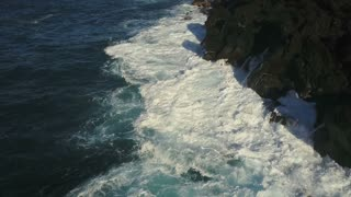 Aerial Of Waves Crashing Tnto The Shore