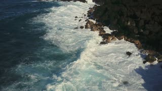 Aerial Of Waves Crashing Into The Shore