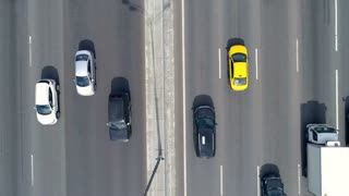 Aerial shot of a busy eight lane road, highway. Car traffic. 4K.