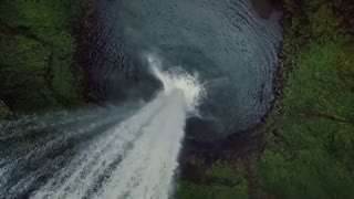 Aerial Slow Mo Rotating Around Waterfall
