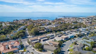 Aerial time lapse in motion or hyperlapse over coastal California residential neighborhood