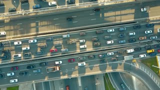 Aerial top down descending shot of a traffic jam on a city highway in the rush hour. 4K video