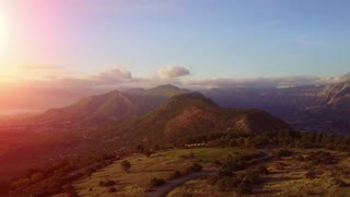 Aerial view from Drone to Mountain Landscape in Europe. Violet sunset in mountains