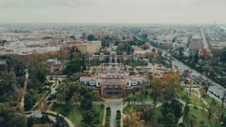 Amazing and inspirational mesmerizing epic aerial drone footage of royal gardens and park in old european city of seville, spain. Beautiful architecture of castle or palace