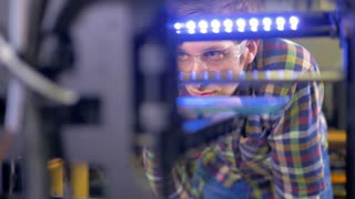 An engineer controls 3d-printer work.