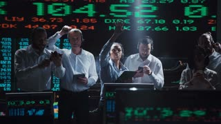 An enthusiastic stock broker team in a futuristic office full of live global market feeds