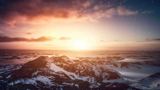 Antarctic Nature. Stony island in ocean. Beautiful colorful sunset cloudy sky. Snow falling. Majestic winter landscape. Beauty world, holidays, sports and recreation. Travel background. Slow motion 4K
