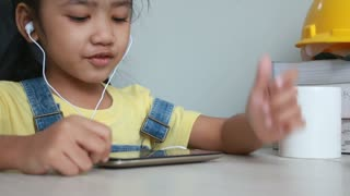 Asian Little Girl Using Smartphone With In Ear Head Phone Close Up 001