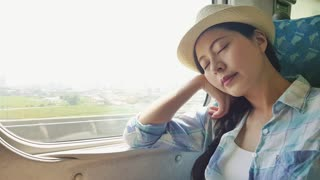 Asian woman traveler take a break and falls asleep
