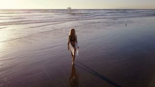 Attractive Blond Woman Walking on the Beach